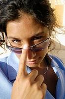 Cute young executive woman in her twenties, half asian half spanish, wearing sunglasses