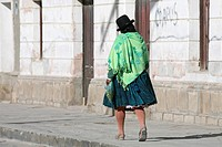 Woman in traditional dress wearing bowler hat and skirt at Uyuni, Altiplano, Bolivia