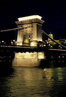 Hungary, Budapest. Chain bridge spanning Danube River, Royal Palace in background