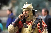 Roman soldier talking on a mobile phone, Rome, Italy