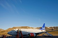 Norway, Svalbard, Longyearbyen, Midnight sun lights SAS Airbus 320 jet on runway after arrival