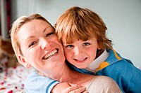 Portrait of a young boy hugging his mother (thumbnail)