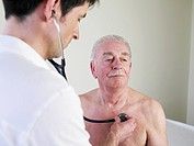 Germany, Hamburg, Doctor examining patient with stethoscope in clinic