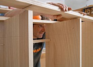 Germany, Upper Bavaria, Schaeftlarn, Carpenter fixing wood