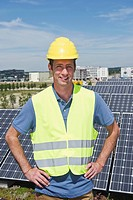 Germany, Munich, Technician in solar plant, smiling, portrait