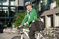 Germany, Bavaria, Mature man on bicycle, portrait, smiling