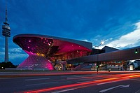 Twilight view of the main entrance to BMW Welt BMW World , a multi-functional customer experience and exhibition facility of the BMW Company with traf...
