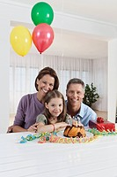 Germany, Munich, Family celebrating birthday, smiling, portrait