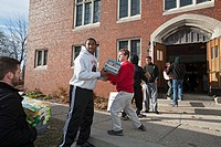 Pontiac, Michigan - Students of Orchard Lake St  Mary´s, a Catholic boys school, unload food which will be distributed to low-income families for Than...