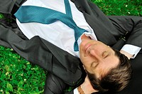 Senior people series _ mature business man lying in grass and relaxing