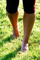 woman`s feet on a meadow