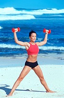 woman does doing sports with two Free weight at the beach _ broad_legged stand
