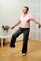 older woman doing gymnastics _ balance _ stand on one leg _ senior