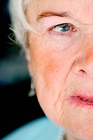 Half _ portrait of a female senior citizen`s face