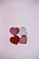 four small thin hearts on violet basis