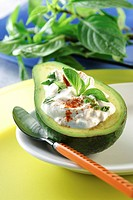 Avocado filled with curd _ avocado _Persea americana contains vitamin E B6 magnesium potassium copper and is rich at unsaturated fatty acids