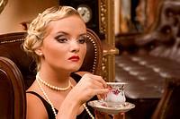 Woman drinking tee.