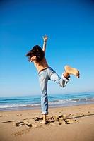 woman back at Arenal Moris beach in Asturias Spain