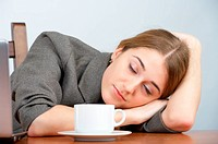 Beautiful businesswoman sleeping at her workplace