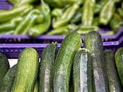 Boxes of vegetables with zucchini and green peppers