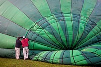 Hot air balloon preparing for flight over Garrotxa Natural Park,Girona province  Catalonia  Spain