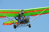 Male ultralight pilots flying over, Camarillo, California, USA