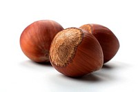 macro picture of three hazelnuts in white background