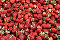 Strawberries on a counter in an open marketplace