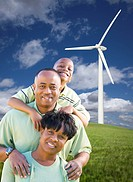 Happy African American Family and Wind Turbine