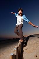 Young man doing balances