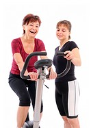 Spinning senior woman with coach
