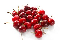 cherry red wet fruits macro on white