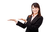 Attractive businesswoman shows your product