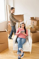 Man and woman unpacking things in new house