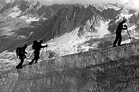 Three men climbing in French Alps close to Chamonix, close to Aiguille du Midi, close to Mt Blanc, France