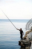 Fisherman at the port outside Rhodes old Town, Rhodes, Greece