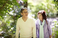 Senior Couple Walking and Talking on Path