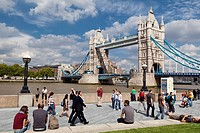 England, London, Tower Bridge. People walking along the Thames path on the South Bank by Tower Bridge.