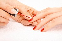Process of drawing red varnish on the female nails