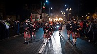 Scotland, South Lanarkshire, Biggar. Biggar Pipe Band leads the torchlight procession through the streets on News Years Eve to light the Biggar Bonfir...