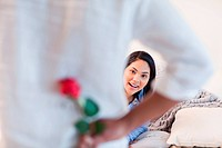 Young female about to get a rose by her boyfriend