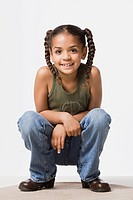 Studio portrait of smiling girl 8_9 with plaits