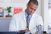 Portrait of male doctor at desk