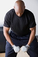 Man weighting dumbbells