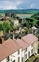 Medieval Conwy Castle, built by King Edward I, Snowdonia, in the Gwynedd region of north Wales  Over rooftops from the town wall