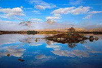 Scotland, Argyll and Bute, Rannoch Moor. Rare combination of clouds, mirror reflections, and mist slowly clearing the mountains by Lochan na h_Achlais...