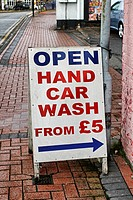 England, Warwickshire, Nuneaton. Hand car wash sign on a pavement