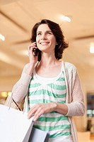 Woman on cell phone and shopping