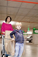 Mother grocery shopping with son