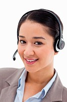 Portrait of a happy office worker posing with a headset against a white background